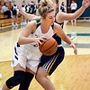 John P. Cleary | The Herald Bulletin<br /> Pendleton's Brynn Teague works her way along the baseline against Delta's Kassidy Dishman.