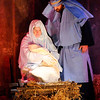 Don Knight | The Herald Bulletin<br /> Mary and Joseph look upon the baby Jesus in the manger during the Live Nativity at Maple Grove Church of God on Saturday.