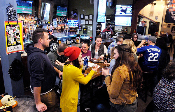 Don Knight | The Herald Bulletin The Anderson Smart Axes talk about their answer to a question during Top Live Trivia at Kettle Top Brewhouse on Tuesday. The team has been playing trivia since the start but routinely change up their name.