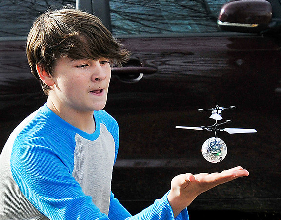 John P. Cleary | The Herald Bulletin<br /> Kaed Abshire, 13, learns how to control his new Christmas gift, an Induction Crystal Ball, Tuesday afternoon as he plays outside his home on Monroe Street in Alexandria.
