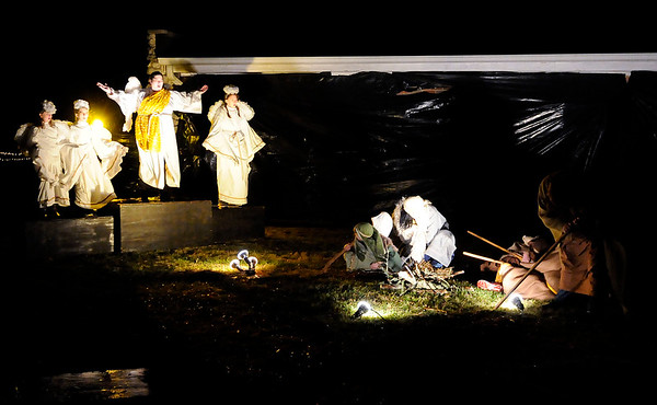 Don Knight | The Herald Bulletin<br /> An Angel of the Lord tells shepherds about the birth of Jesus during a Live Nativity at Maple Grove Church of God on Saturday.