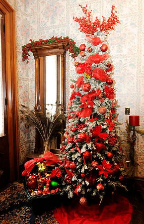 Don Knight | The Herald Bulletin<br /> A large Christmas Tree stands in the entrance way to the historic Gruenewald House as it is decorated for the holidays.