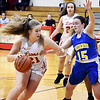 John P. Cleary | The Herald Bulletin<br /> Liberty Christian's Paige Grant drives into the lane a Burris defender, Jenna Lis, tries to cut her off.