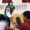 John P. Cleary | The Herald Bulletin<br /> Anderson High School cross country runner Sharon Kulali hands out her Athletes of Character card to fifth-grade students at Tenth Street Elementary School Thursday during an Athletes of Character event at the school.<br /> <br /> <br /> <br /> Athletes of Character from Anderson High School talk to fifth-graders at Tenth Street Elementary School.