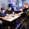 Don Knight | The Herald Bulletin<br /> Kenny Riddle turns in a sticky note with his team's answer to a question during Top Live Trivia at Kettle Top Brewhouse on Tuesday. Riddle was playing with the Rebel Raible Rabble Rousers.