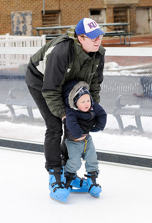 Don Knight   The Herald Bulletin Andrew Gale skates with his two-year-old son Eli on the synthetic skating surface at Dickmann Town Center on Saturday.