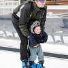 Don Knight | The Herald Bulletin<br /> Andrew Gale skates with his two-year-old son Eli on the synthetic skating surface at Dickmann Town Center on Saturday.