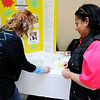 Don Knight | The Herald Bulletin<br /> From left, Debbie Danner, executive director of Lil Miracles stamps Angie Pitts card during the Season of Giving Gift Fair at the Union Building on Saturday.