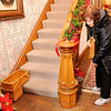 Don Knight | The Herald Bulletin<br /> Executive House Director LaVella Wallace demonstrates a hidden compartment in the newel post during a holiday tour at the historic Gruenewald House on Saturday.