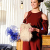 Don Knight | The Herald Bulletin<br /> Olivia Dunn models a cold shoulder dress and fuzzy purse during the Christmas Tea at Gaither Studios on Saturday.