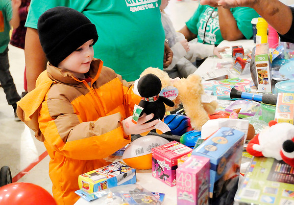 Don Knight   The Herald Bulletin<br /> Jax Laplante, 6, decides between plush toys during the City Wide Toy Giveaway at the UAW on Saturday.