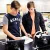 Don Knight | The Herald Bulletin<br /> Owen Thompson, left, and Kole Stewart model chromosomes duplicating during mitosis.