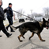 John P. Cleary | The Herald Bulletin<br /> Anderson Police K-9 unit searches along Webster and Poplar Streets for evidence after the Key Bank at 2246 Broadway was robbed Monday afternoon.