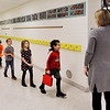 John P. Cleary | The Herald Bulletin<br /> East Elementary School kindergarten teacher Christiane Griffin watches as her students walk through the hallway to their classroom.