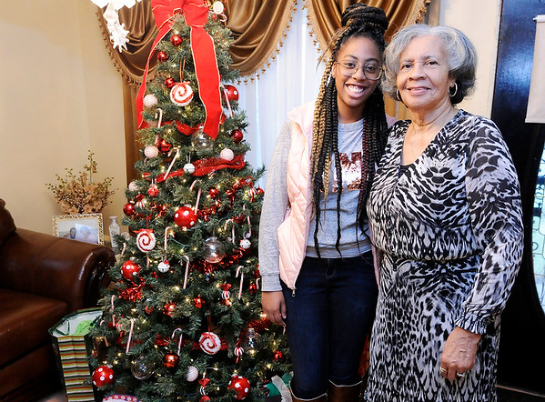 Don Knight | The Herald Bulletin<br /> Jai Jackson, 17, with her grandmother Delores McGee. Jackson's favorite Christmas memory is from last year, celebrating the holiday with her grandmother who only days earlier was released from the hospital.