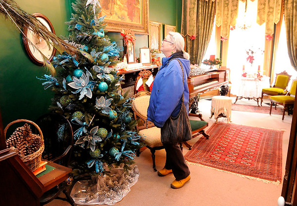 Don Knight | The Herald Bulletin<br /> Irene Alexander tours the historic Gruenewald House during their holiday tour on Saturday. A master gardener Alexander had volunteered in the house gardens but hadn't had a chance to see inside until Saturday.