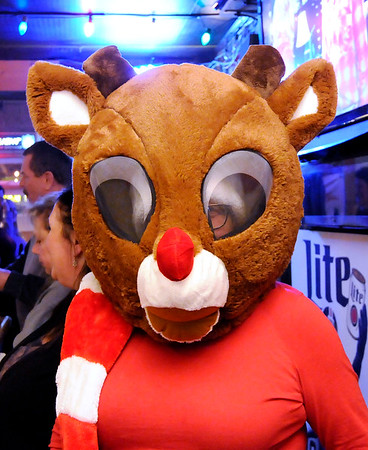 Don Knight | The Herald Bulletin<br /> Belinda Fleenor wore a Rudolph mask for the Ugly Christmas Sweater contest and silent auction at Moranís Bar and Grill on Saturday.