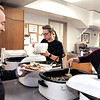 John P. Cleary | The Herald Bulletin<br /> Tim Patton gets a serving of green beans from Sylvia Clark during the annual St. Mary's Catholic Church Christmas day dinner in Alexandria.
