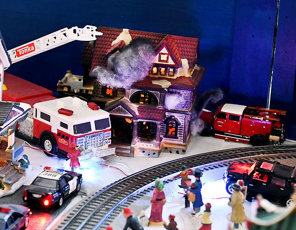 John P. Cleary | The Herald Bulletin<br /> Larry Davenport's train display at the Paramount Theatre as part of the Festival of the Trees.  Detail abounds like this scene of a house fire.