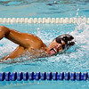 John P. Cleary | The Herald Bulletin<br /> Liberty Christian's Juan Cabello digs in on the final leg of the 200 freestyle to win the event during their meet with Elwood Monday evening.