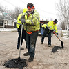 John P. Cleary | The Herald Bulletin<br /> Anderson Street Department workers brave the cold as they fill potholes along Poplar Street in North Anderson Monday afternoon.