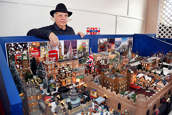 John P. Cleary | The Herald Bulletin<br /> Larry Davenport stands by one of his favorite sections of his model train layout, London Town.