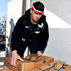 John P. Cleary | The Herald Bulletin<br /> Daniel Bowmer, of Red Hot Motors, stacks another box of turkeys onto a skid at Operation Love Ministries as he and other volunteers delivered 200 turkeys to distribute<br /> to area shelters and food pantries for the holidays. Red Hot Motors and PNC Bank donated the funds to purchase the turkeys for families in need this holiday season.