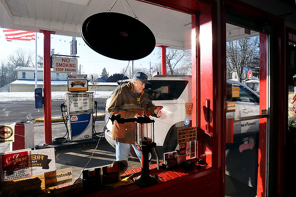 John P. Cleary   The Herald Bulletin<br /> Norman Day of Day's Marathon Service in Middletown takes care of another customer with his full service station.