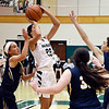 John P. Cleary | The Herald Bulletin<br /> Pendleton's Kylie Davis pulls up for a jumper between several Delta defenders.
