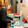 Don Knight | The Herald Bulletin<br /> Asa Doster, 12, adds gliter to her card during at the Anderson Museum of Art on Saturday. The Holiday Card event was the third in the museum's Family Fund Day series.