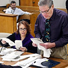 Recount Commission members Tonia Wainscott and David Beeman hand count paper ballots from Anderson City Council District 5 Wednesday during the District 5 recount. Republican Art Pepelea Jr. filed for the recount last month after losing the election to incumbent Democrat Lance Stephenson by 14 votes.