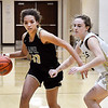 Lapel's Delany Peoples tries to get a step on Madison-Grant's Zoey Barnett as she drives with the ball.