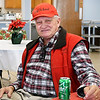 Richard Stowe, of Aroma, has been eating Christmas dinner for 10 years at St. Mary's Catholic Church and says it's a way for him and his wife, Cathy, to socialize with people on Christmas.