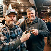 The Oakley Brothers, Jerrad and Jason, enjoy a toast with their favorite distilled sprit at the bar of their distillery at 8th & Jackson Streets in Anderson.