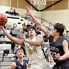 Lapel's Cole Alexander leans out to protect the ball from Elwood's Colton Limoges as he drives the lane for a shot.