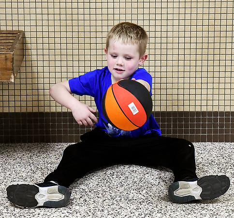 Cade Wilson, 5, from Fairmount, was more interested in playing with his own little basketball then watching the Lapel take on Madison-Grant girls in round ball Tuesday evening at Madison-Grant High School.