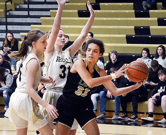 Madison-Grant's Azmae Turner and Zoey Barnett put the pressure on Lapel's Delany Peoples as she tries to drive the baseline.