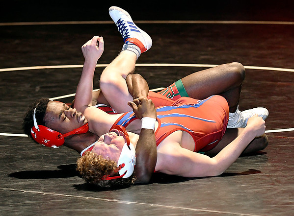 Elwood's Damien Gmurk Jr. grimaces as Anderson's Willie Dennison gets him a a hold during their 126 pound match Wednesday. Dennison went on to pin Gmurk to win the match.