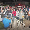 A large crowd showed up at the home of cancer-stricken Anderson Firefighter Brent Holland to seenade him and his family with Christmas Carols lead by Martha Green (center).   (Mark Maynard photo)