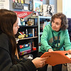 Donna Hubble, right, discusses the history lesson with senior Brileigh Cagley in her Honors U.S. History class Monday at Anderson High School. Hubble, a retired teacher of 11 years, has come back to the classroom as a substitute teacher for the last four years.