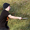 Reece McDaniel lets a shot fly Thursday as he and friends enjoy a warm afternoon playing golf at the Sanders Memorial Disc Golf Course at Edgewater Park.
