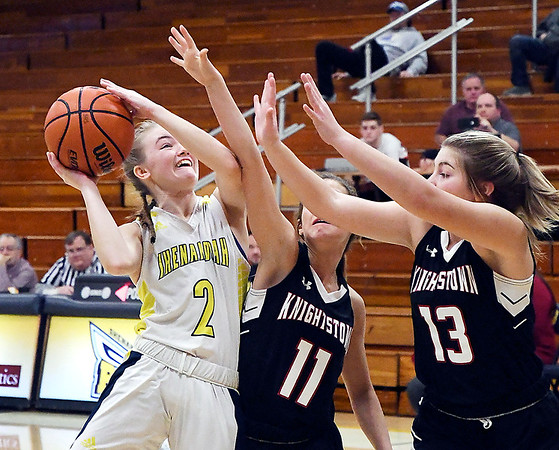 Shenandoah's Kathryn Perry draws a foul as she drives to the basket on the opening play of the game against Knightstown. Perry hit both foul shots to to score her 1,000th point in her high school career.