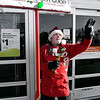 "Salvation Army bell ringer Jan Presley greets everyone with a wave and a ""Merry Christmas"" as he works at the grocery entrance to Walmart in Anderson Tuesday."