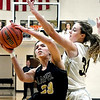 Lapel's Delany Peoples alters her shot as Zoey Barnett of Madison-Grant tries to block the ball.