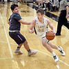 Lapel's Kolby Bullard gets a step on Elwood's Trenton Porter as he drives toward the basket.