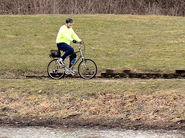 The cold front that brought lower temperatures to the area didn't stop this guy from getting outdoors to get some fresh air and exercise as he rides his bike around the paths through Pulaski Park Friday afternoon.