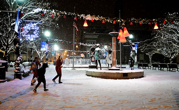 A second round of snow started to fall over the area early Monday evening giving another coating of the white stuff making Dickmann Town Center look a lot more like Christmas.
