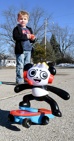 4 year-old Brogan Combs was having fun playing with his new  RC Combo Panda Skateboard that Santa brought him for Christmas. Brogan, who lives in Alexandria, was playing in an vacant lot across from his house where he had more room to operate his new toy.
