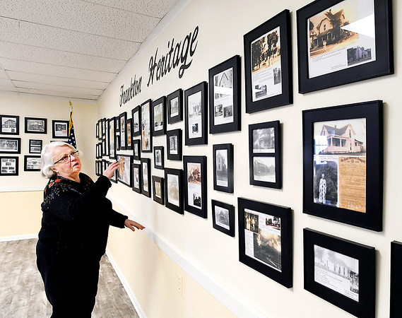 Loretta Richardson, of the Frankton History Club, looks over the historial photos that are now on display in the meeting and activities room of the Frankton Heritage Days Building where the club meets.