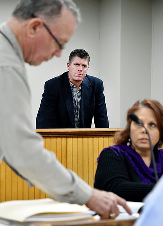 Democrat Lance Stephenson, Anderson City Council District 5, watches as members of the Recount Commission go about counting the paper ballots for District 5 from the Nov. 5 general election after Republican challenger Art Pepelea Jr. filed for a recount after losing to Stephenson by 14 votes.